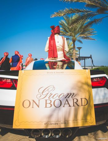 Fun groom entry idea with sign on car