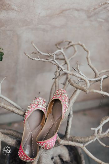 Photo of Bridal juttis with pearl work in pink
