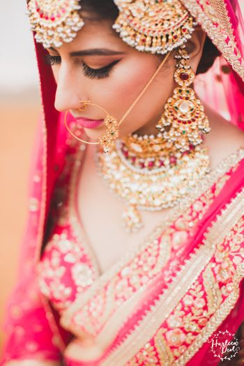 Photo of Matching red polki and jadau jewellery with red lehenga