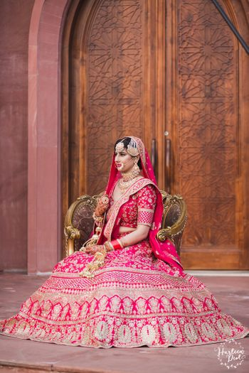 Photo of Regal bridal portrait pose in red lehenga