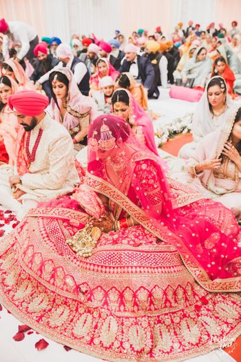 Photo of Red Sabyasachi bridal lehenga flared out