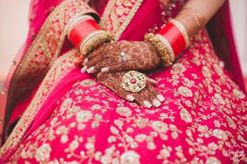 Photo of Bridal hands with cocktail ring with red stone