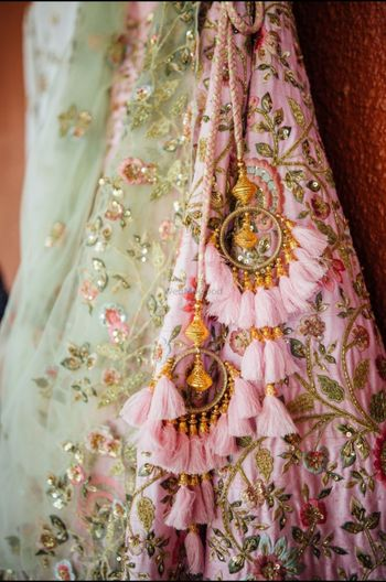 Pretty pink andgold bridal latkans for an Indian wedding