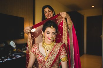 Photo of Pretty Bride while getting ready