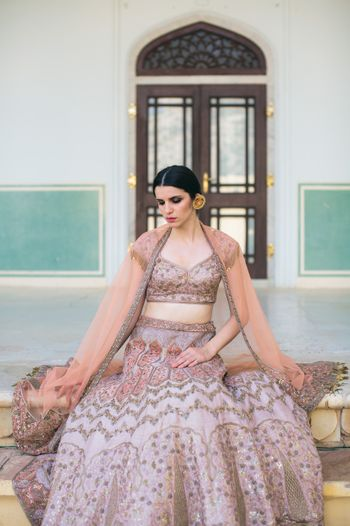 Photo of Lilac engagement lehenga with dull gold embroidery