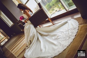 Christian bride portrait in a trail gown
