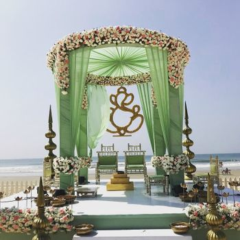 A floral mandap decor with green curtains