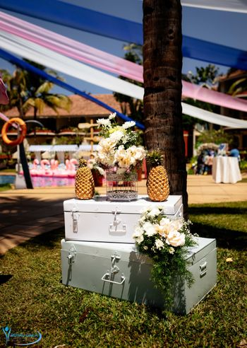 Hand-painted trunks with pineapple and flowers for a photobooth.
