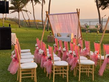 Pink Chair decoration for an outdoor wedding setup.