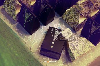 Photo of suit shaped box invites