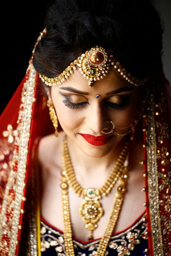 Bridal makeup with Smokey gold eyes and deep red lips
