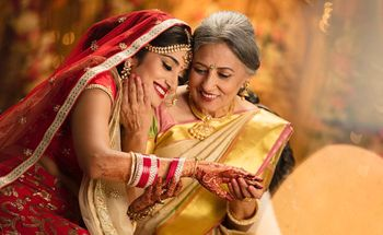 Happy picture of a bride with her mother.