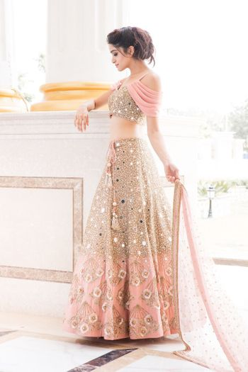Pretty peach lehenga with mirror work and falling sleeves blouse