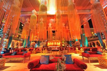 Orange Themed Decor with Floral Chandeliers