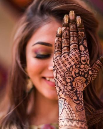 Intricate mehndi design for back of the hands