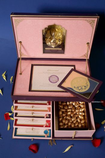 Unique wedding invite box with cards Ganesha idol and favours