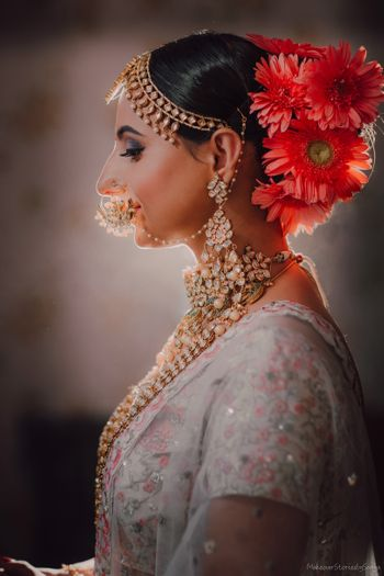 Red bridal bun contrasting with lehenga