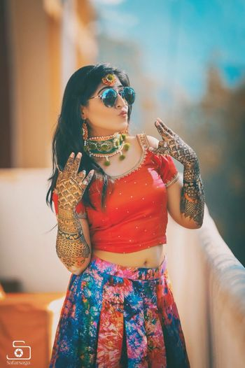 Cool bride shot on mehendi wearing glasses