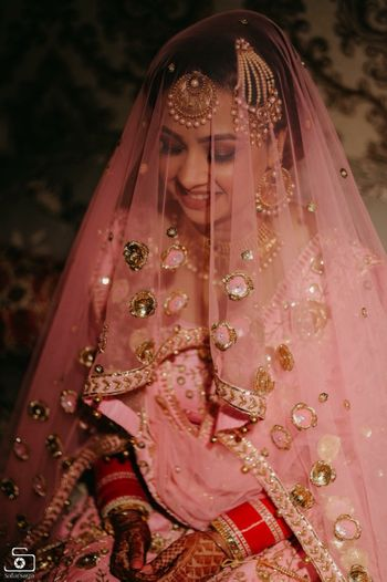 Beautiful bridal portrait with pink and gold lehenga for wedding