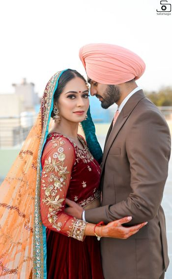 A beautiful couple portrait of a Sikh bride and groom.