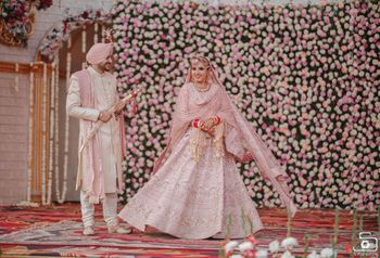 Sikh couple color-coordinating in pink & white.