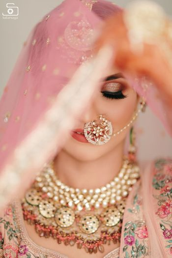 bridal portrait with pretty nath and pink smokey eye