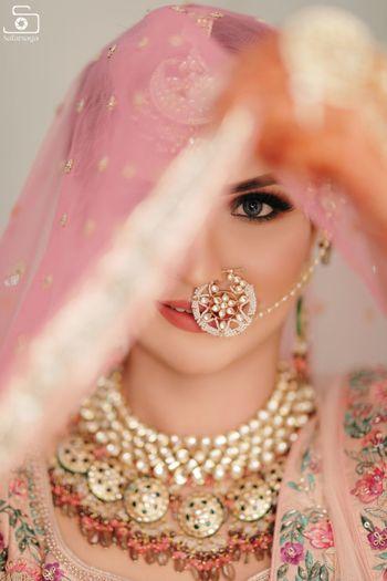 pretty bridal portrait idea with a unique nath