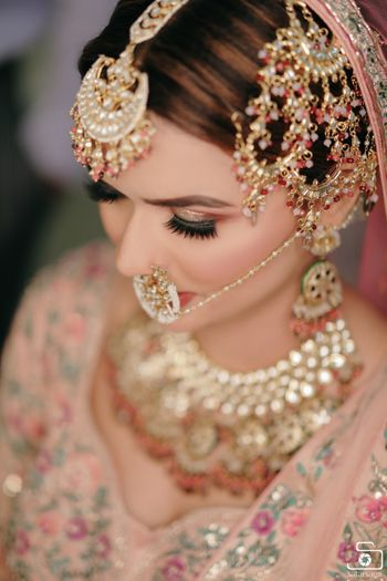 pretty bridal jewellery with pink beads and oversized jhoomar