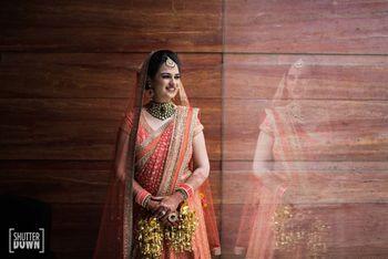 Bride in orange lehenga and kaleere