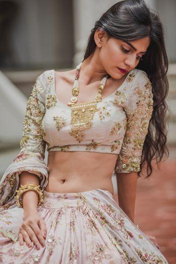 Engagement look with blush pink lehenga