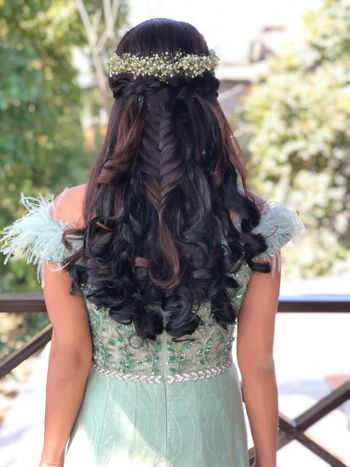 Braided half up half down hairdo for brides