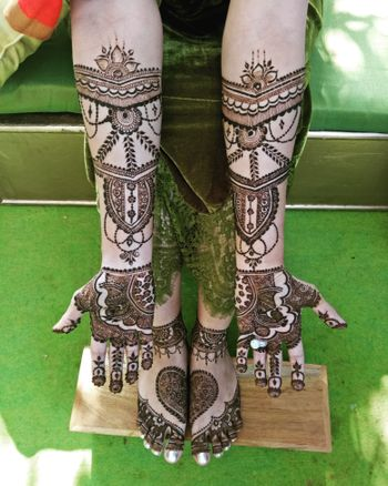 Photo of Symmetrical beautiful mehendi designs for hands and feet.