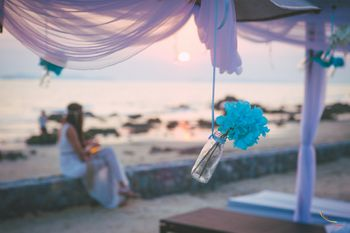 Beach Wedding Decor with Hanging Bottle and Flowers