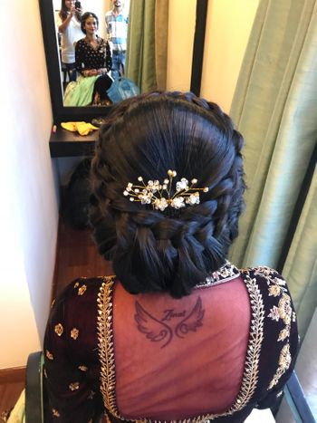 Stunning braided bridal bun with pearl hair accessories