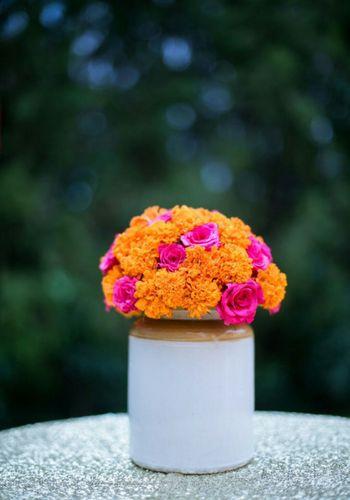 Rustic mehendi decor pickle jar with flowers