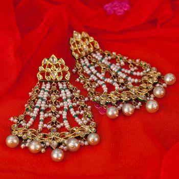 Photo of Gold jhoomer earrings