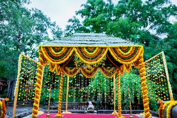 Photo of Mandap with genda phool and green decor