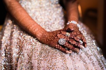 Bridal hands with mehendi and cocktail ring