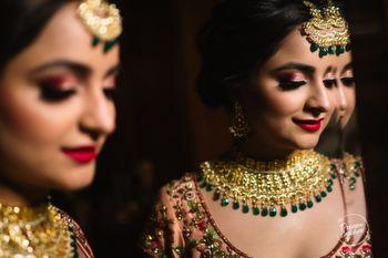 Photo of Mirror reflection bridal portrait idea in maroon lehenga