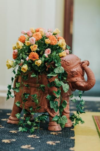 Cute elephant used as a prop with floral arrangements