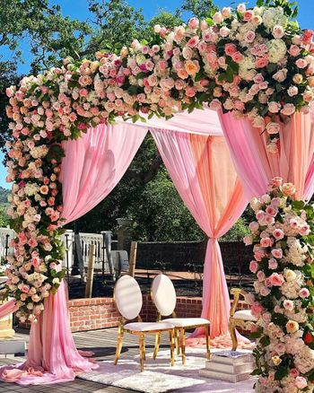 Floral mandap with pink drapes