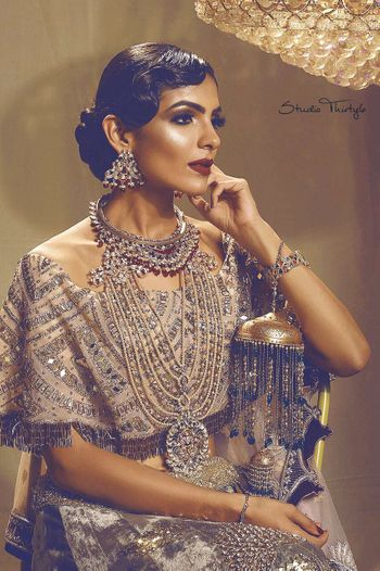 Photo of Bold makeup with retro hairstyle for sangeet