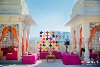 Photo of Bridal mehendi seat with colourful backdrop