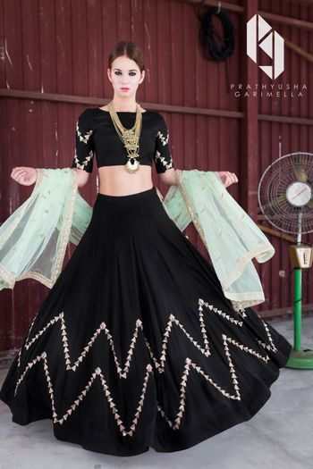 Black and gold lehenga with mint dupatta