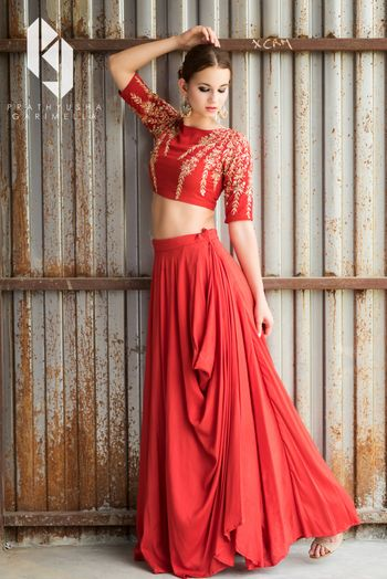 Simple red and gold lehenga for sister