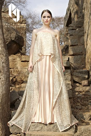 Peach and gold off shoulder cape lehenga