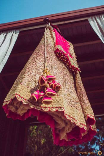 Pink and gold bridal lehenga with unique tassels