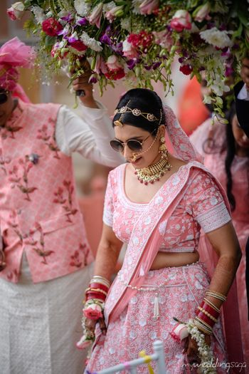 Bride wearing hairband and sunglasses