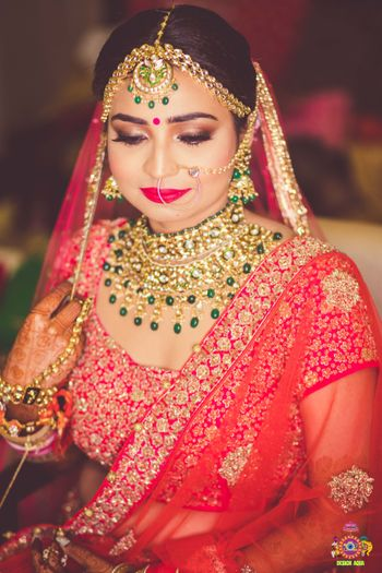 Pretty gold jewelry with green beads for wedding