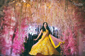 Mehendi lehenga bride twirling